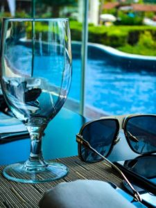 photo-of-pool-and-wine-glass