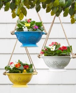 ordinary-kitchen-colanders-painted-different-colors-and-hung-like-planters