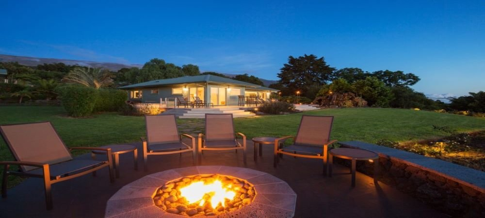 firepit out on the backyard of a bungalow ready for evening sit around