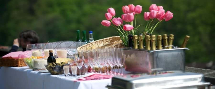 table-laid-with-champagne-glasses-and-bottles