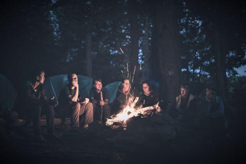 people around a bonfire