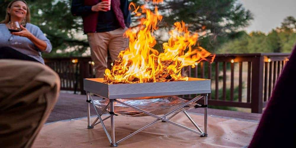 popup wood burning firepit in full flame