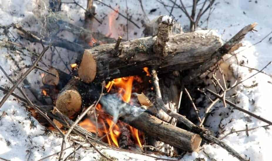 log-fire in snowy conditions
