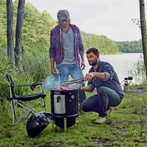 this weber 14 inch smoker can be taken anyware and is good for up to four people when grilling or smoking